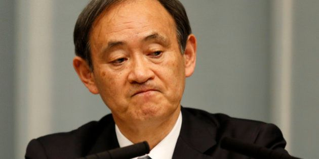 Japan's Chief Cabinet Secretary Yoshihide Suga attends a news conference at Prime Minister Shinzo Abe's...