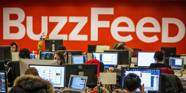 Buzzfeed employees work at the company's headquarters in New York January 9, 2014. REUTERS/Brendan McDermid/File