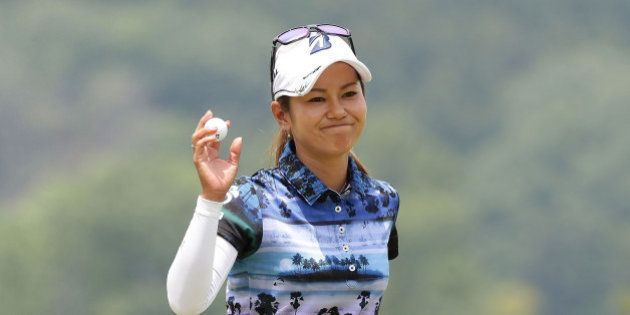 TOYOTA, JAPAN - MAY 21: Ai Miyazato of Japan reacts after a putt on the 18th green during the final round...