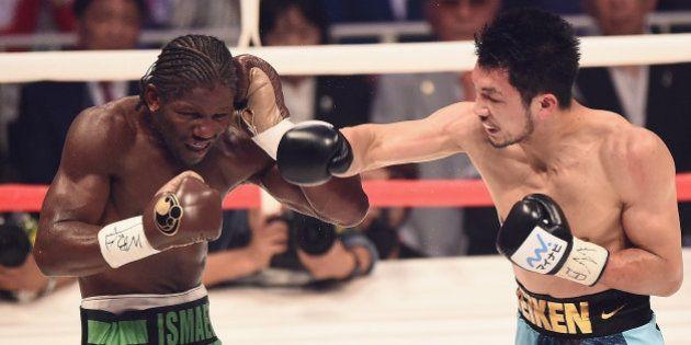 TOKYO, JAPAN - MAY 20: Ryota Murata of Japan punches Hassan N'Dam N'Jikam of France during the WBA World...