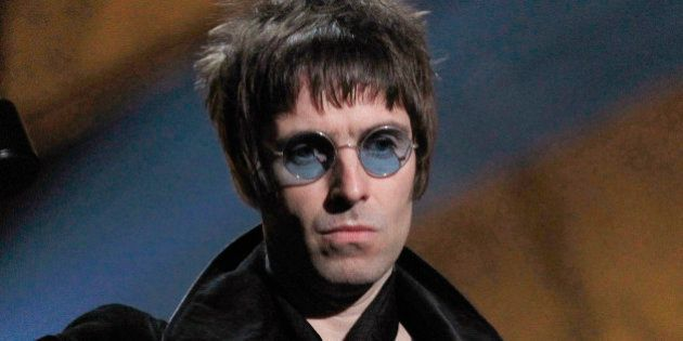 Liam Gallagher of Oasis holds up his award for Best Album of 30 years at the 30th Brit Awards ceremony...
