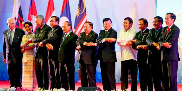 Southeast Asian leaders link arms at the opening of the 28th and 29th ASEAN Summits and other related...