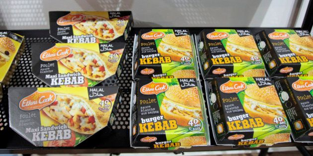 A picture taken on March 31, 2010 shows boxes of Kebab burgers shown during the Halal expo, part of the...
