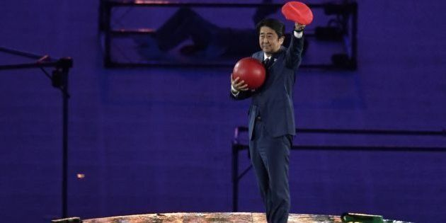 Japanese Prime Minister Shinzo Abe holds a red ball during the closing ceremony of the Rio 2016 Olympic...