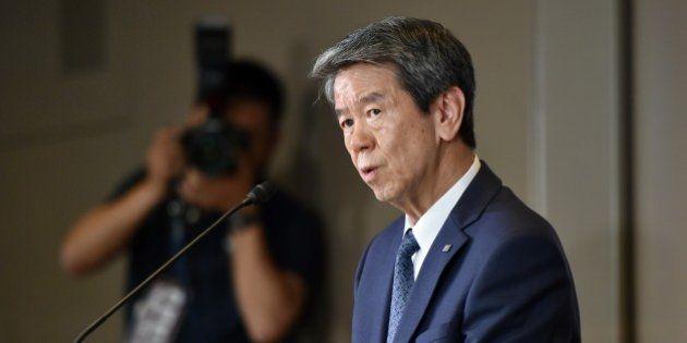 Japan's electronics giant Toshiba president Hisao Tanaka speaks to the press at the company's headquarters...