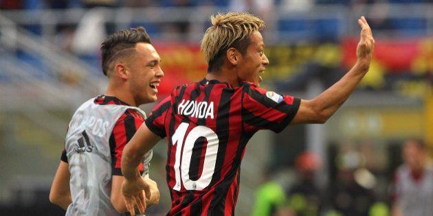 MILAN, ITALY - MAY 21: Keisuke Honda (R) of AC Milan celebrates his goal with his team-mate Lucas Ocampos...
