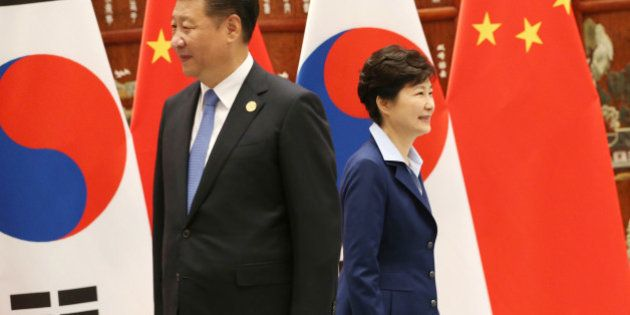 South Korean President Park Geun-hye, right, walks past Chinese President Xi Jinping during their meeting...