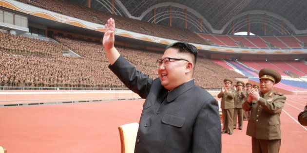 North Korean leader Kim Jong Un waves to the members of the Korean People's Army in this undated photo...