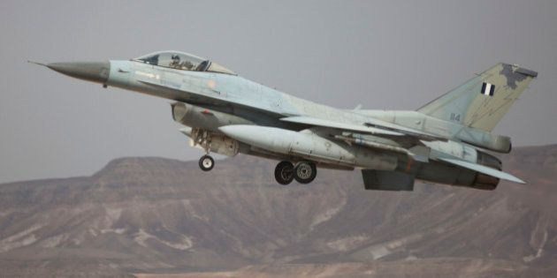 EILAT, ISRAEL - DECEMBER 09: A Greek F-16 jet takes off on December 9, 2014 at the Ovda airbase in the...