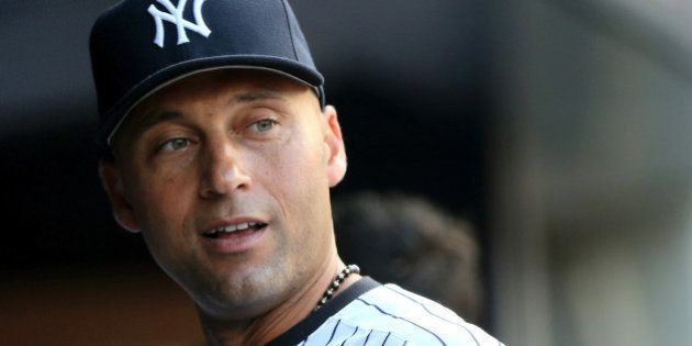 NEW YORK, NY - JULY 22: Derek Jeter #2 of the New York Yankees looks on from the dugout before the game...