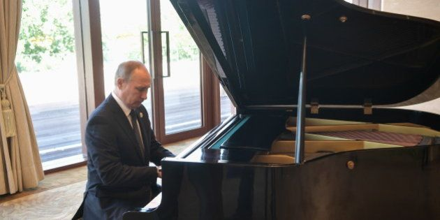 BEIJING, CHINA - MAY 14, 2017: Russias President Vladimir Putin plays the grand piano ahead of a meeting...