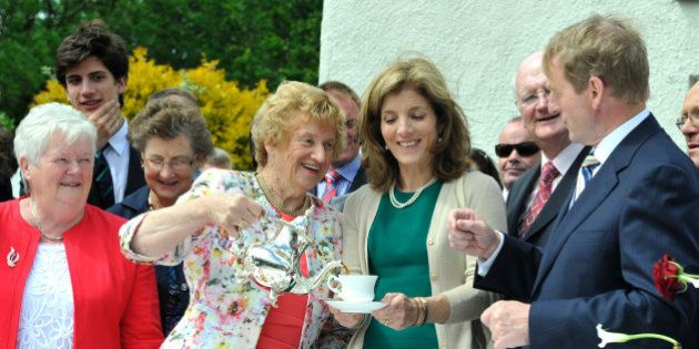 NEW ROSS, IRELAND - JUNE 22: Anna Rowe, Caroline Kennedy and Enda Kenny recreate the tea party of John...