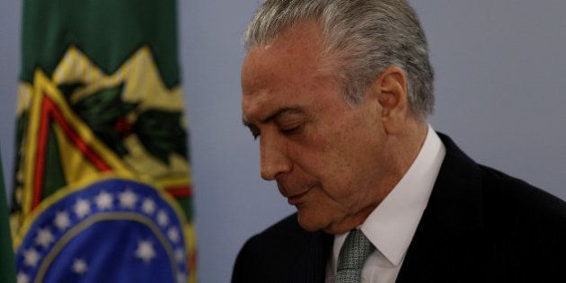 Brazil's President Michel Temer reacts as he speaks at the Planalto Palace in Brasilia, Brazil, May 18,...