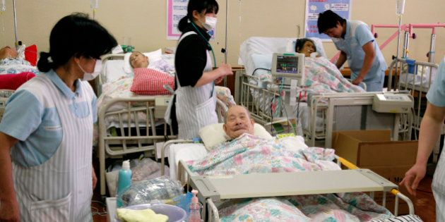 Elderly patients, who were forced to move from a hospital near the Fukushima nuclear plant 60 kms to...