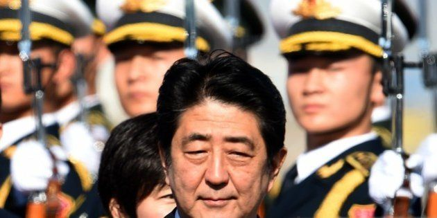 A Chinese People's Liberation Army (PLA) honour guard welcomes Japan's Prime Minister Shinzo Abe on arrival...