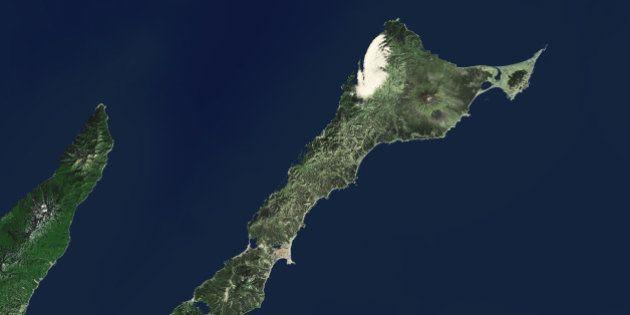 Kunashir Island Japan: This is an enhanced Landsat 7 Satellite Image of Kunashir island, part of the...