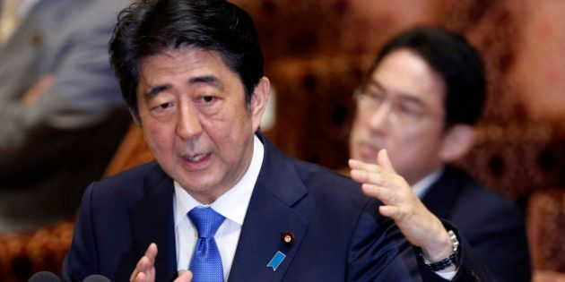 Japanese Prime Minister Shinzo Abe speaks during a parliament committee session regarding controversial...