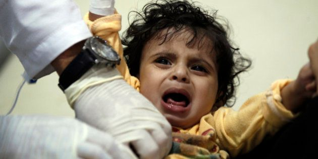 A Yemeni child, suspected of being infected with cholera, receives treatment at a hospital in Sanaa on...