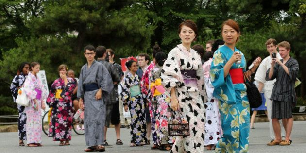 HIMEJI, JAPAN - JUNE 22: Japanese women dressed in Yuakata, a summer kimono ,walk as foreigners dressed...