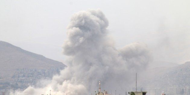 DAMASCUS, SYRIA - MAY 04: Smoke rises after Assad regime forces attacked opposition controlled Qaboun...