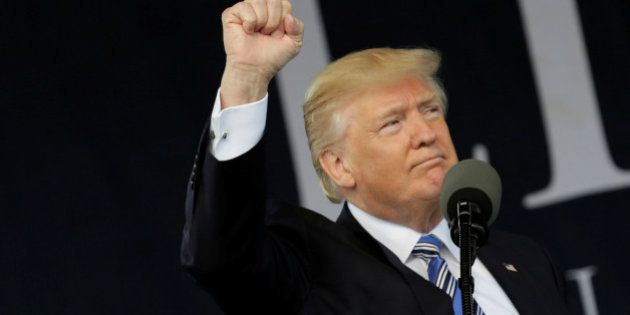 U.S. President Donald Trump gestures after delivering keynote address at commencement in Lynchburg, Virginia,...