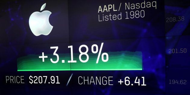 An electronic screen displays the Apple Inc. stock price at the Nasdaq Market Site in New York City,...