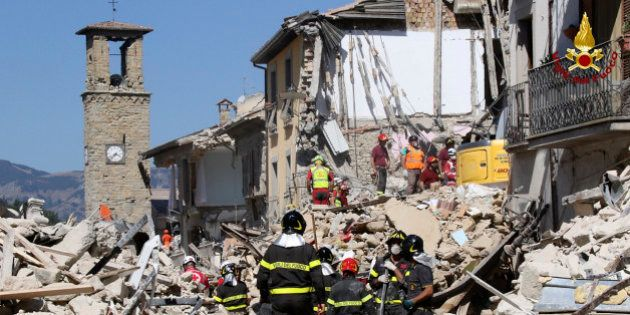 Rescuers work amid collapsed building in Amatrice, central Italy, Thursday, Aug. 25, 2016. Rescue crews...