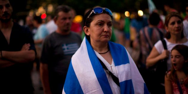 Demonstrators gather near the Greek Parliament during a rally against the government's agreement with...