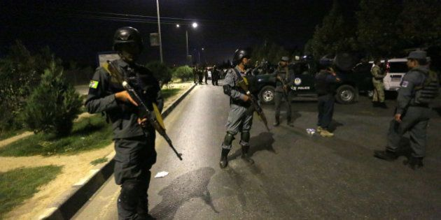 Afghan security forces respond to a complex Taliban attack on the campus of the American University in...