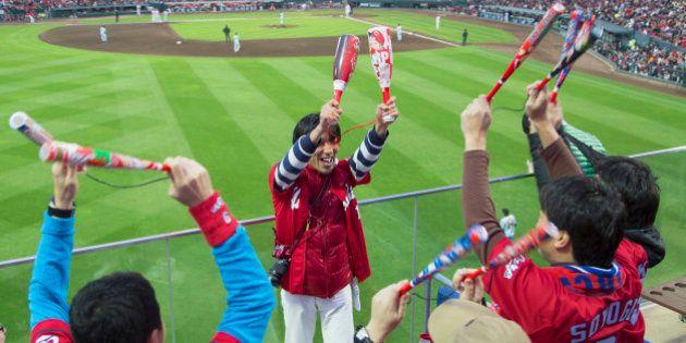 Fans celebrating at baseball match of Hiroshima Toyo Carps inside MAZDA Zoom-Zoom Stadium, Hiroshima,...
