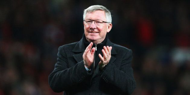MANCHESTER, ENGLAND - APRIL 22: Sir Alex Ferguson, manager of Manchester United celebrates victory and...