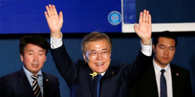 South Korea's president-elect Moon Jae-in gestures to supporters at Gwanghwamun Square in Seoul, South...