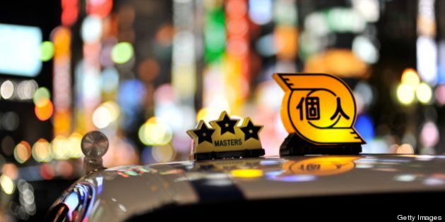 [UNVERIFIED CONTENT] A taxi in shinjyuku tokyo. The background are the buildings lining the kabukicho...