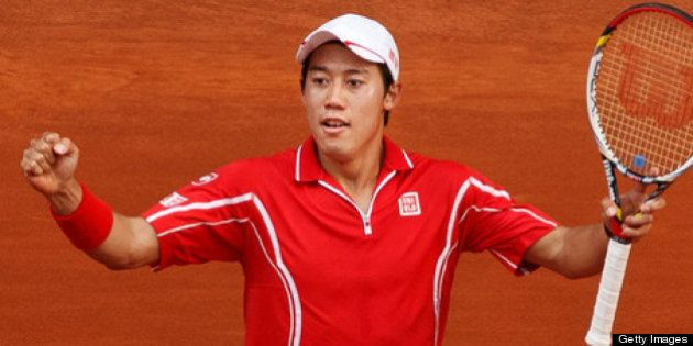 MADRID, SPAIN - MAY 09: Kei Nishikori of Japan celebrates matchpoint after winning his match against...