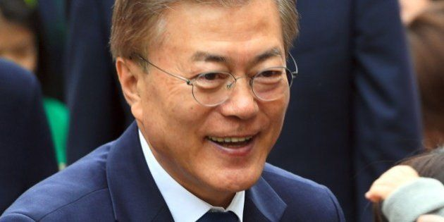 South Korean presidential candidate Moon Jae-In (C) of the Democratic Party greets his supporters as...