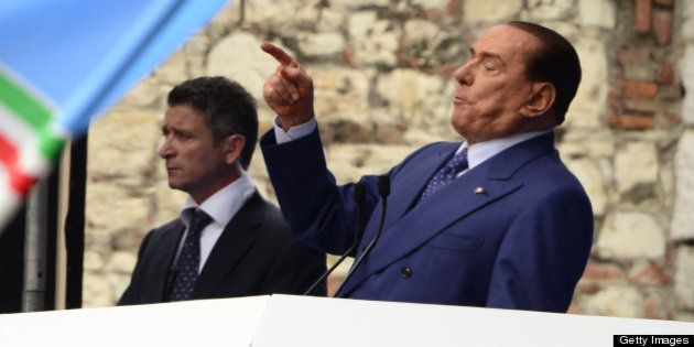 Italian former Prime Minister Silvio Berlusconi delivers a speech during a rally organised by the People...