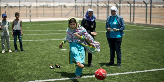 Nobel Peace Prize recipient Malala Yousafzai, 18, kicks the ball while playing soccer with Syrian refugee...