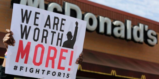McDonald's workers and supporters rally outside a McDonald's, Wednesday, April 15, 2015, in Chicago....