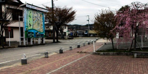 A bicycle is left near the station in the part of the town of Minamisoma, which is inside the 20-kilometer...