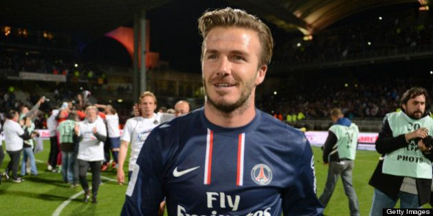 (FILES) Picture taken on May 12, 2013 shows PSG midfielder David Beckham celebrating after Paris Saint-Germain...