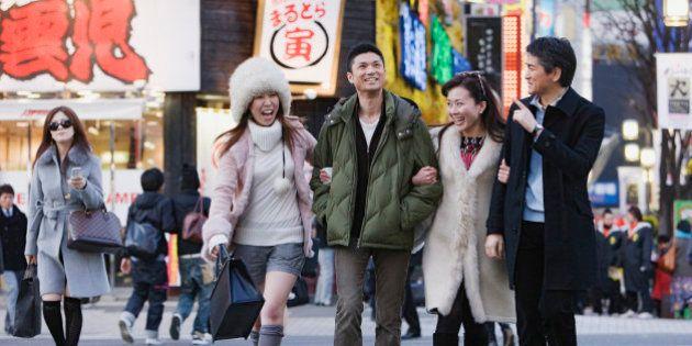 Asian friends crossing
