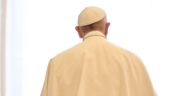 Pope Francis stands following a meeting with President of Switzerland Doris Leuthard at the Vatican May...