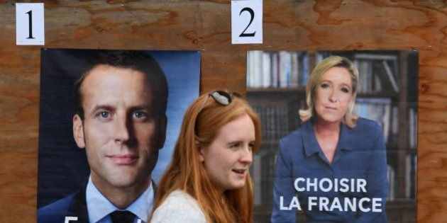 A member of the French expatriate community arrives to vote at an international school polling station...