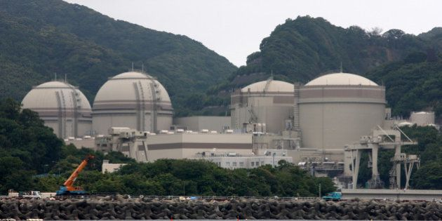 The No. 4, from left, No. 3, No. 2 and No. 1 reactor buildings stand at Kansai Electric Power Co.'s Ohi...