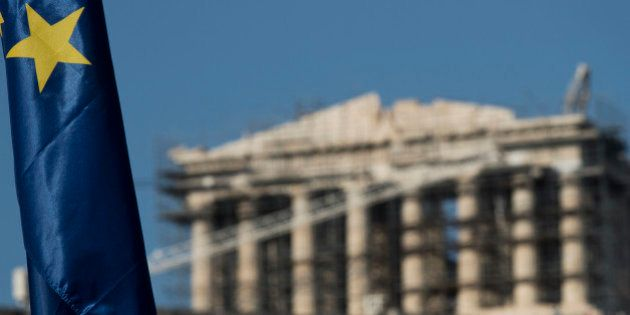 One of the stars of a European Union flag is seen in front of the ancient parthenon temple at the Acropolis...