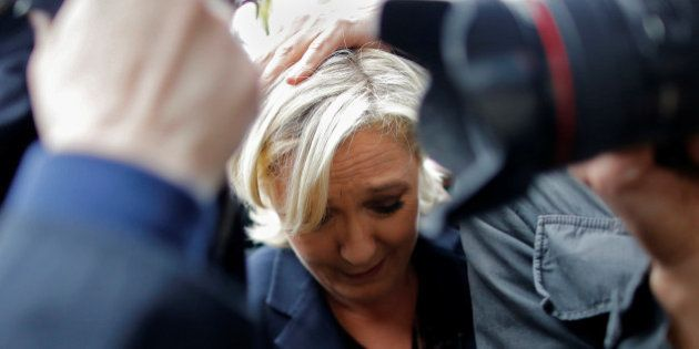 Marine Le Pen, French National Front (FN) party candidate for 2017 presidential election, is protected...