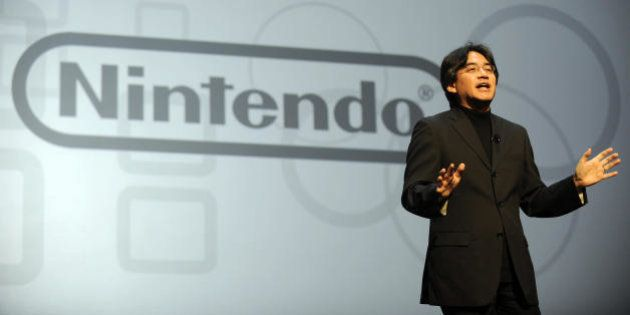 Satoru Iwata, President of Nintendo, delivers a speech during the Nintendo E3 media briefing at the Kodak...