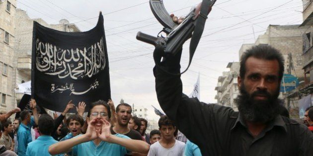 Supporters of the Al Nusra Front take part in a protest against Syrian President Bashar al-Assad and...