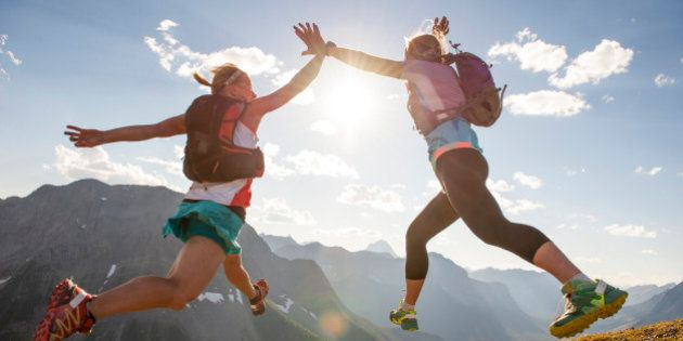 Trail runners exchange mid-air high fives,