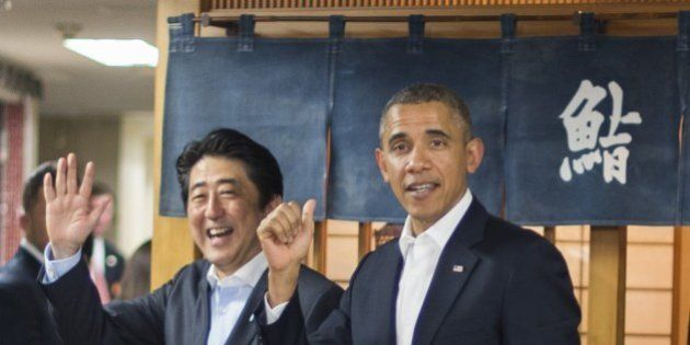 US President Barack Obama (R) and Japanese Prime Minister Shinzo Abe (L) depart after a private dinner...